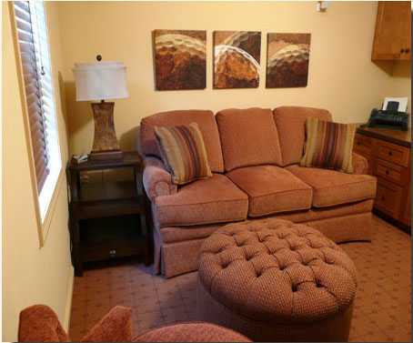 The home office/den/extra guest room sports a comfy sofa bed and a large multi-purpose ottoman.
