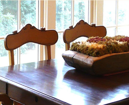 Dining table and chair detail with lovely dried centerpiece in antique bread bowl.