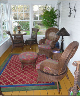 Sun porch with charming Victorian reproduction wicker.