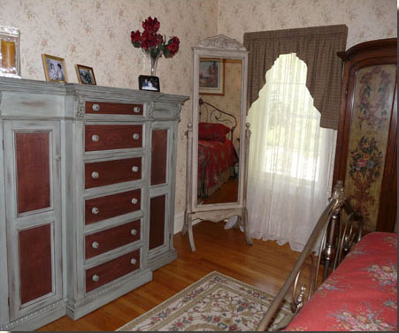 Master bedroom boasts handsome storage and a wonderful period feel.