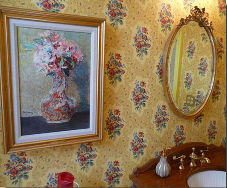 Powder room continues the lovely jewel-toned floral theme and period details.