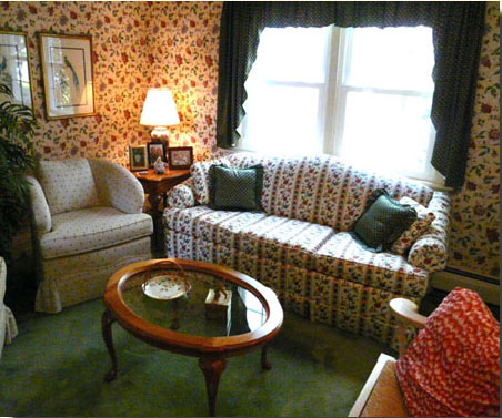 Living room has old-fashioned cozy parlor feel, but easily accommodates ten.