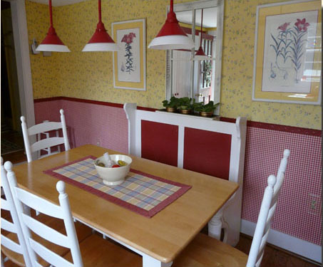 Cheery kitchen features vintage restaurant booth recolored for freshness.