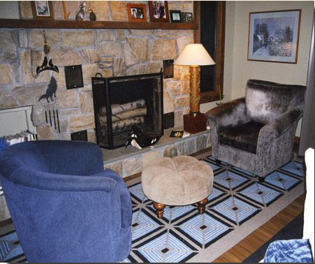 The cozy end of the family room where husband and wife love to read.