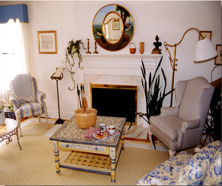 A classic traditional fireplace anchors the conversation areas.