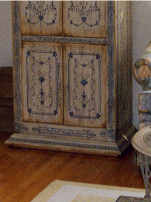 Detail of a hand-painted armoire, a companion piece to the coffee table.  It houses a television and so much more.
