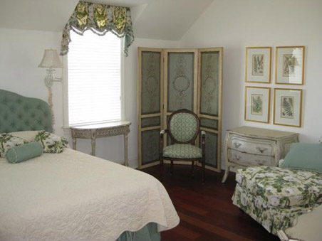 The master bedroom carries the color theme forward and adds more floral motifs.
